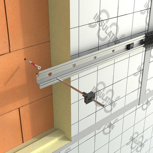 Kotvení přímo k nosné stěně přes distanční šrouby pomocí plastové spony, která drží nosný profil.
